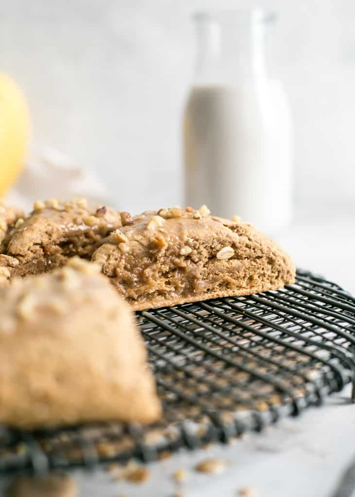 sliced banana scones on black cooling rack with glass of milk