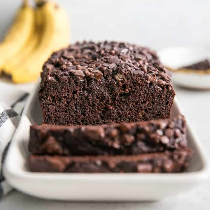 chocolate banana bread on white platter