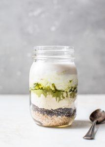 layered matcha overnight oats ingredients in mason jar