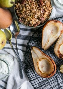 grilled pears on cooling rack with granola and spoons