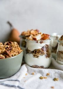 pear parfaits in glass jars with granola bowl