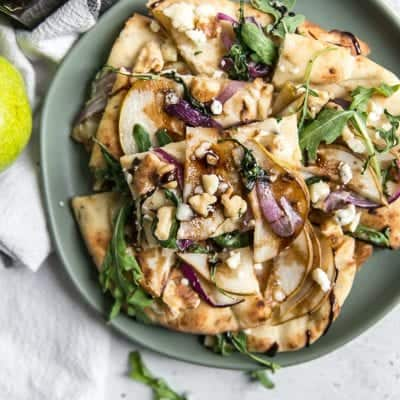 Easy Walnut Pear Flatbread with gorgonzola, arugula, and balsamic glaze