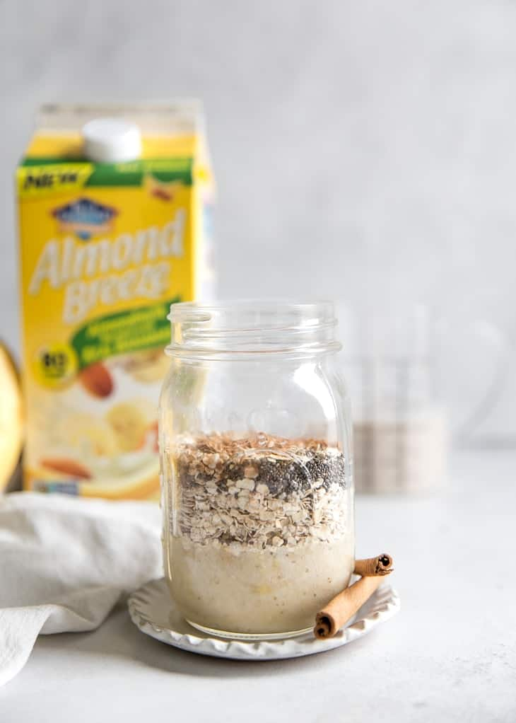 mason jar with ingredients for banana overnight oats