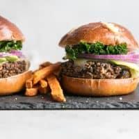 quinoa black bean burgers on slate with sweet potato fries