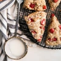glazed strawberry scones on cooling rack