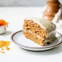 vegan carrot cake with cashew cream frosting on plate