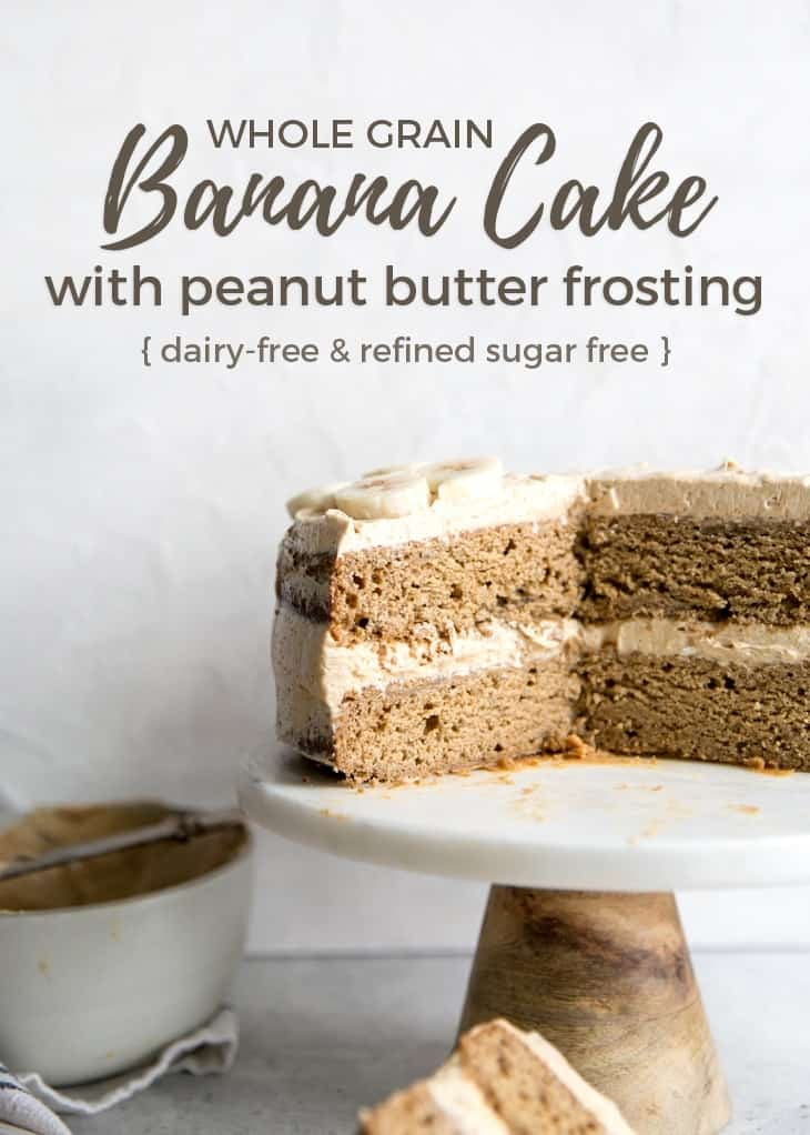 banana cake on stand with peanut butter frosting