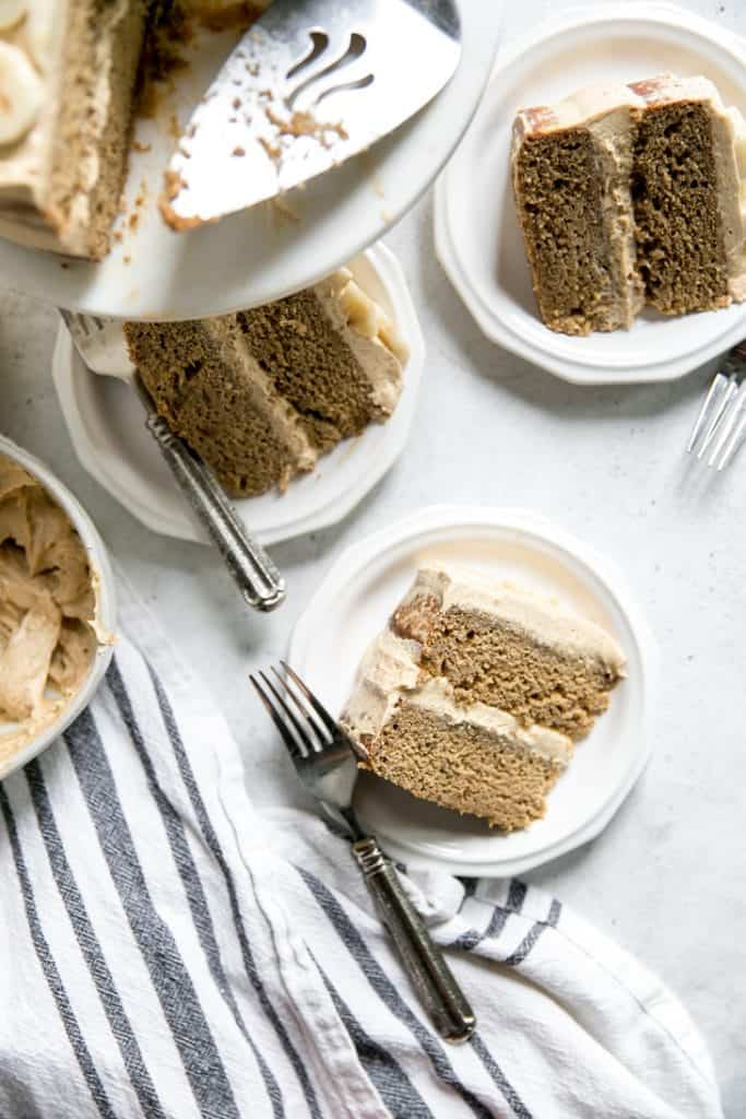 pieces of banana cake on plates with forks