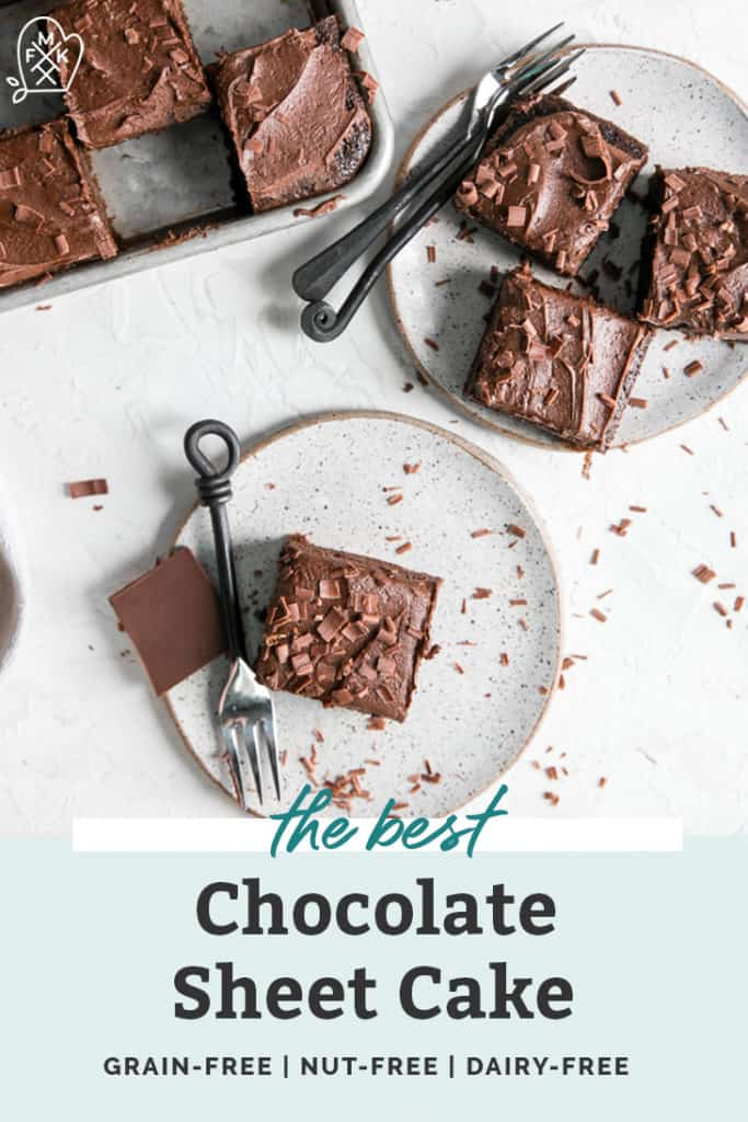 paleo chocolate sheet cake with fork surrounded by chocolate shavings on white plate
