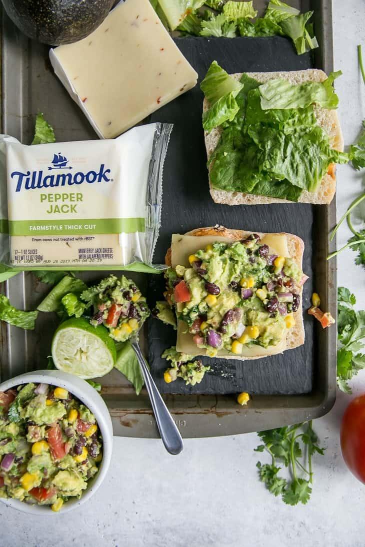 Tillamook Pepper Jack Cheese on tray with ciabatta sandwich