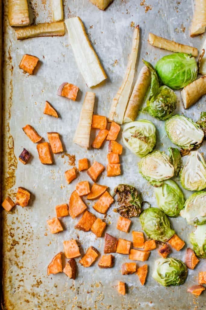roasted sweet potatoes, brussels sprouts and parsnips on sheet pan