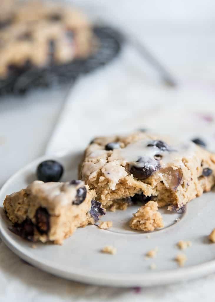 bite of glazed blueberry scones on plate