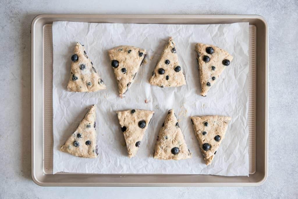 triangle cut scones on baking sheet