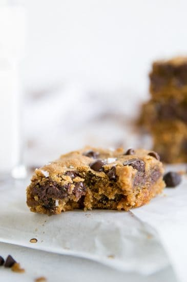 bite out of paleo cookie bar with chocolate chips and sea salt