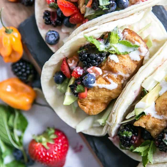 fish tacos with berry salsa on slate