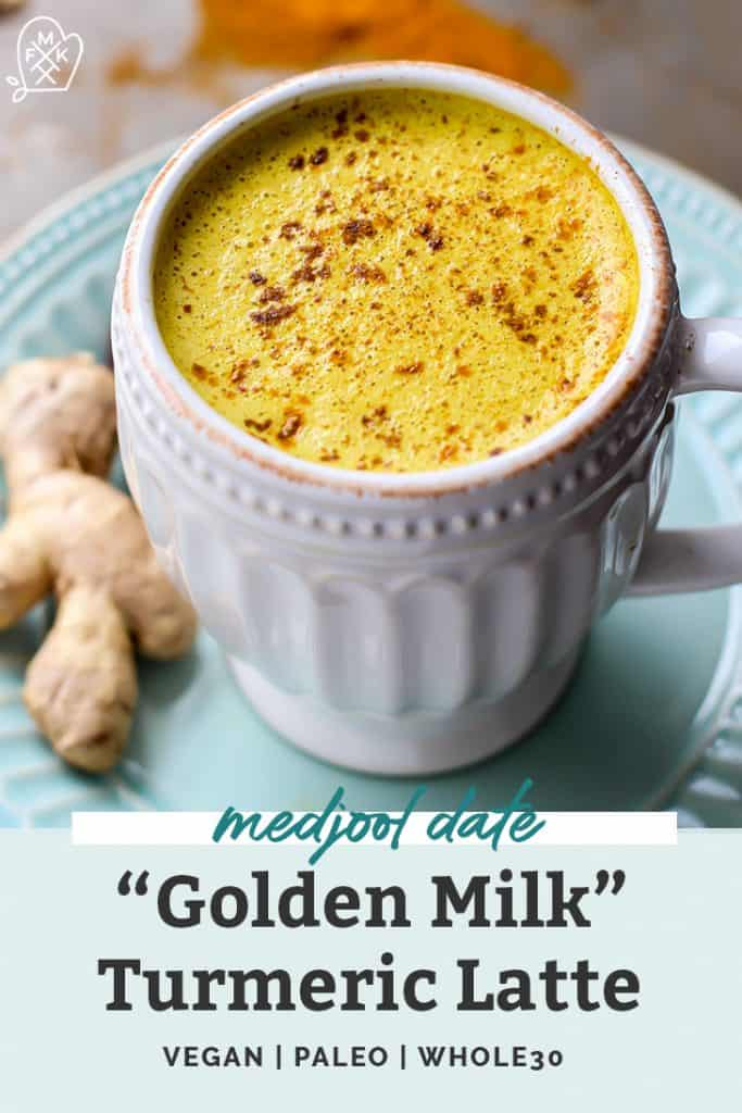 Medjool Date Golden Milk Turmeric Latte in white mug on blue plate