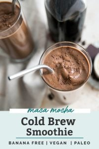 maca mocha cold brew smoothie in clear glasses with metal straw