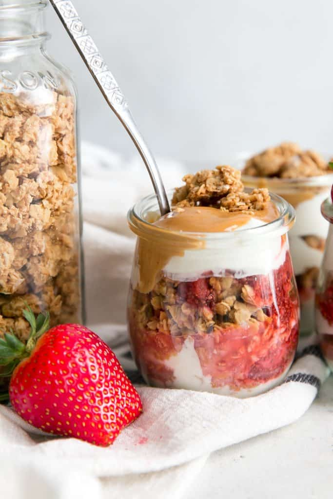 spoon in strawberry peanut butter parfait
