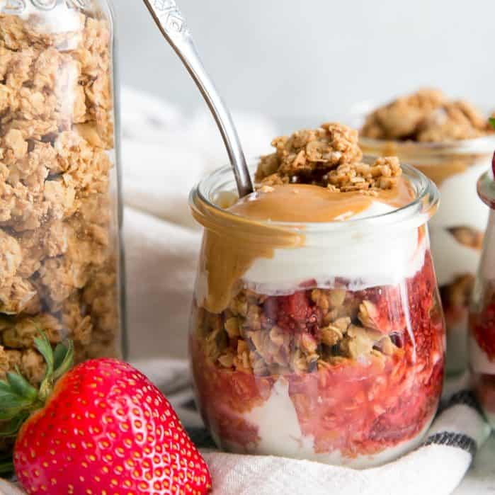 spoon in strawberry peanut butter parfait