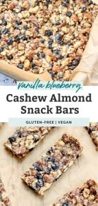 vanilla blueberry cashew almond snack bars on wood counter with text overlay