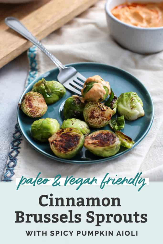 cinnamon brussels sprouts on blue plate with fork