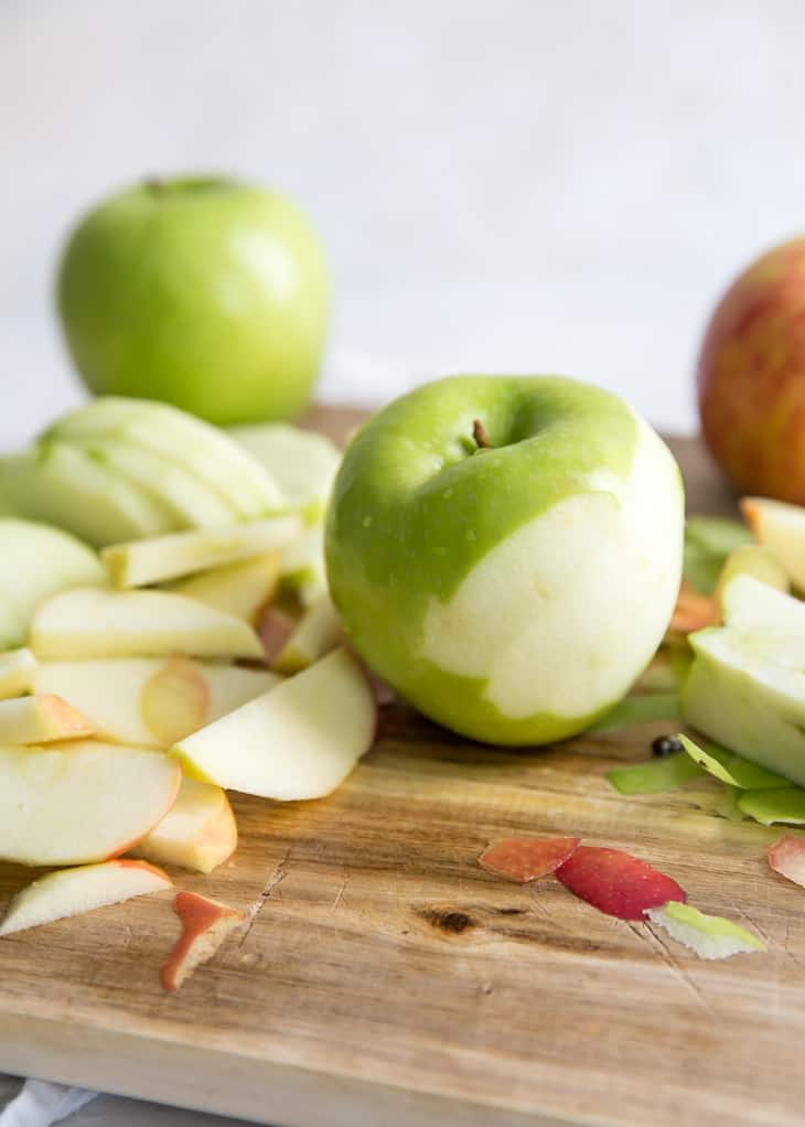 apples peeled on cutting board