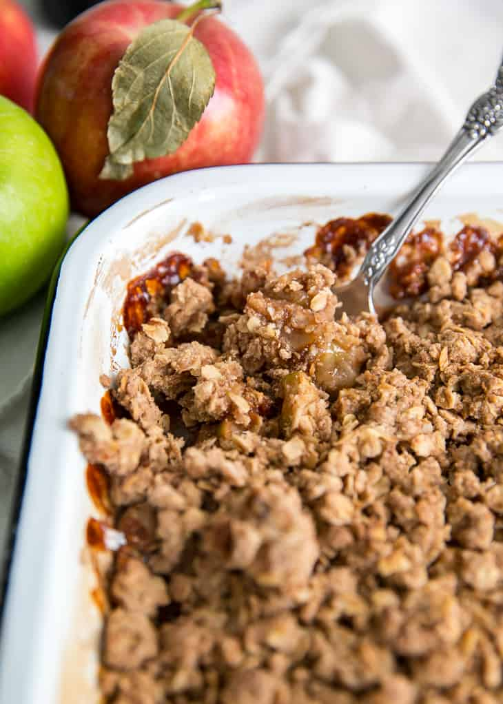 closeup of spoon in apple crisp pan