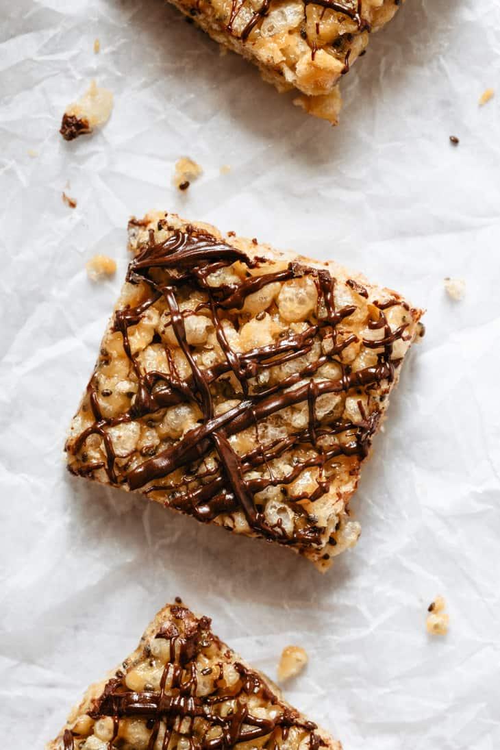 one square peanut butter rice crispy treat with chocolate drizzle