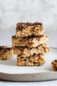 stacked peanut butter rice crispy treats with chocolate drizzle