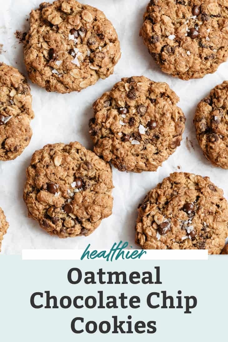 whole wheat oatmeal chocolate chip cookies on white parchment paper