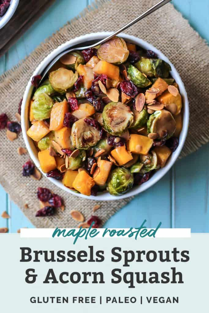 healthy maple roasted brussels sprouts and squash in a white dish with dried cranberries with text overlay