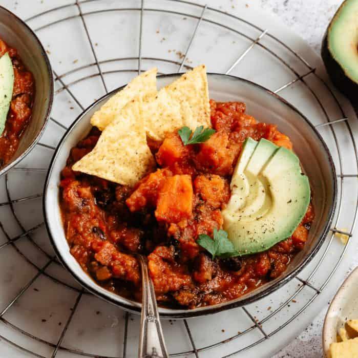 sweet potato black bean pumpkin chili with avocado and chips