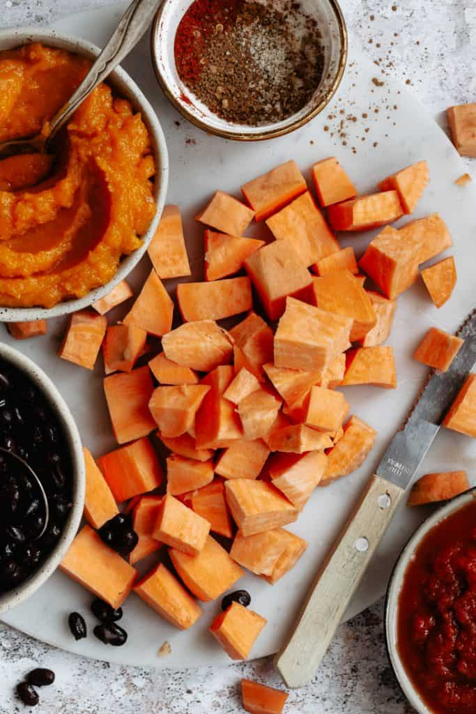 chopped sweet potatoes with pumpkin and black beans