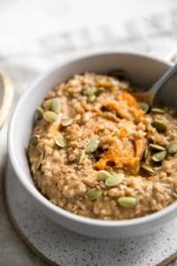 up close image of steel cut oatmeal with pumpkin seeds
