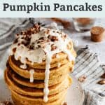 whole wheat pumpkin pancakes topped with melted coconut butter, pure maple syrup and pecans