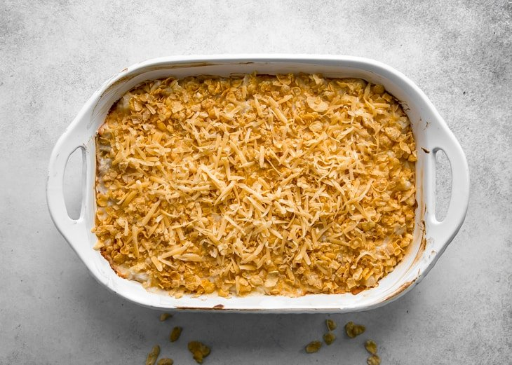 cheese potato casserole with cornflakes in dish