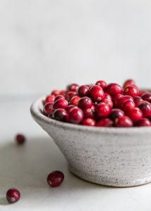 fresh cranberries in white bowl