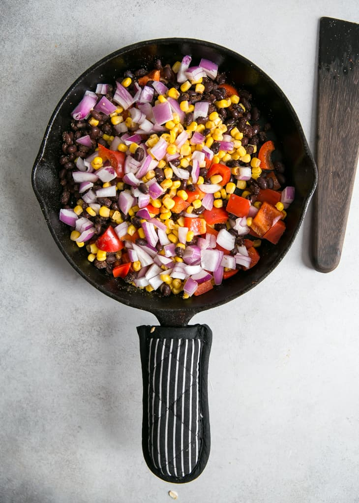 corn, bell peppers and quinoa in skillet