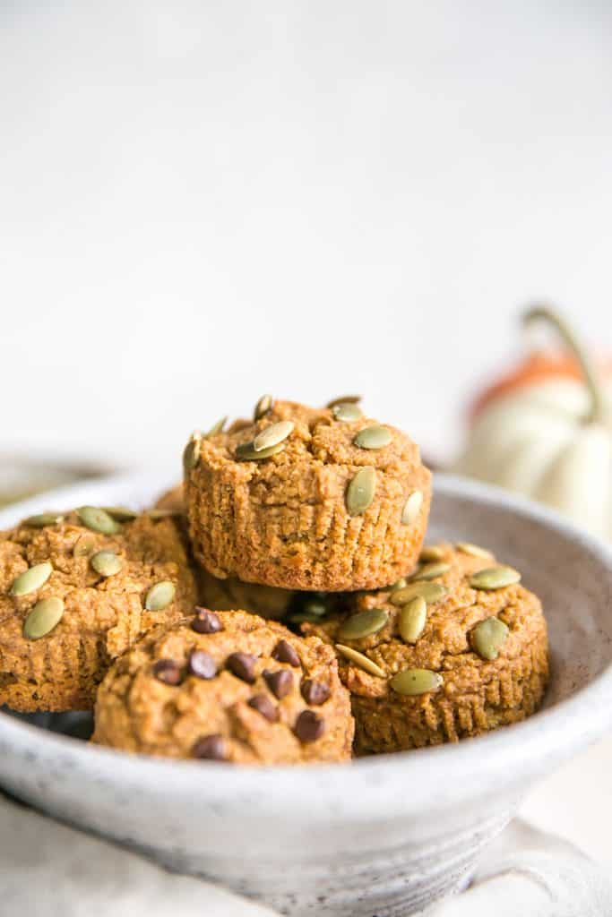 bowl of pumpkin muffins with pepitas