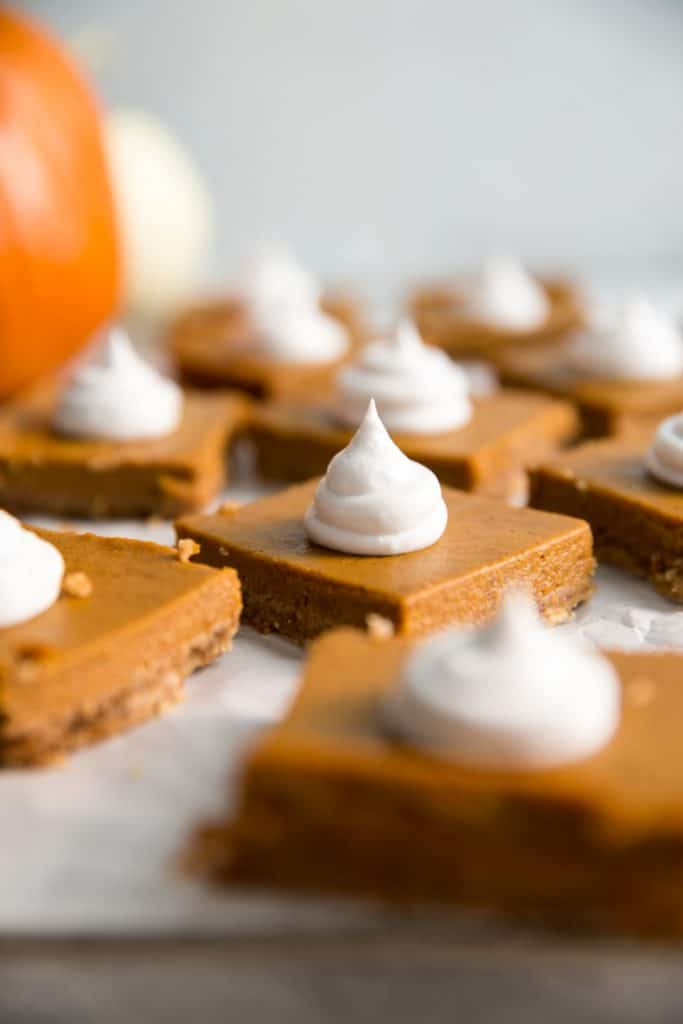 pumpkin pie bars with whipped cream topping