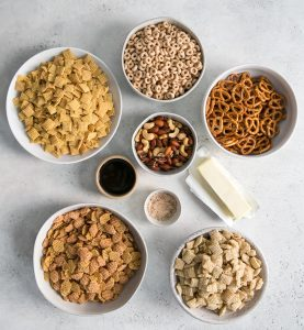 cereal in bowls and ingredients for chex mix