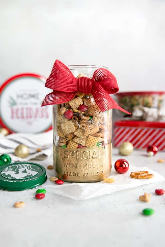 chex mix in glass jar with red bow