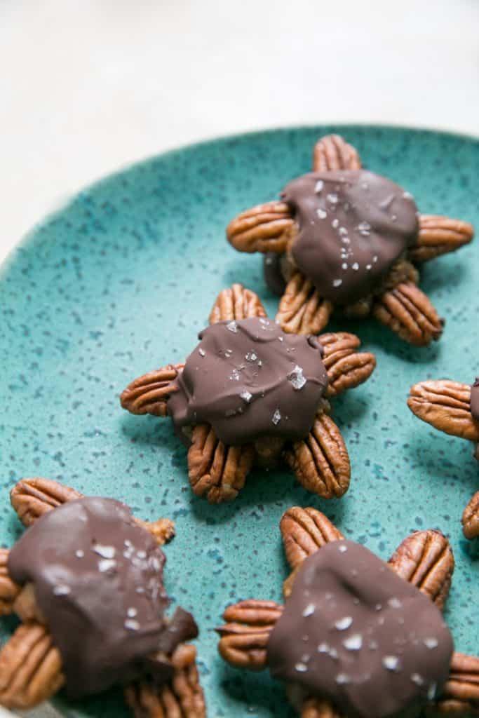 homemade chocolate turtles on blue plate