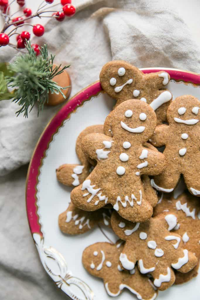 gingerbread cookies on plate next to faux tree