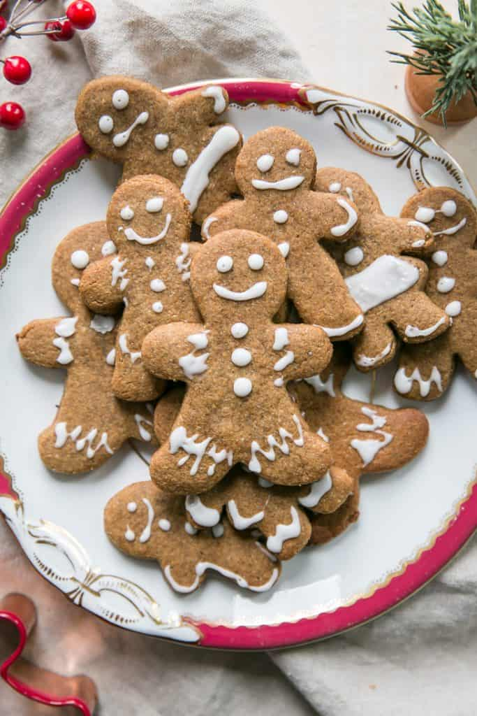 decorated gingerbread cookies on plate with red rim