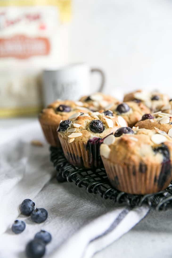 almond blueberry muffins on cooling rack
