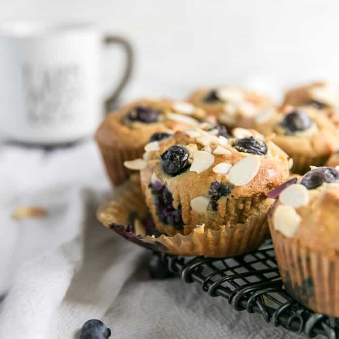 blueberry muffins in liner on cooling rack