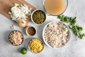 ingredients for white chicken chili in bowls