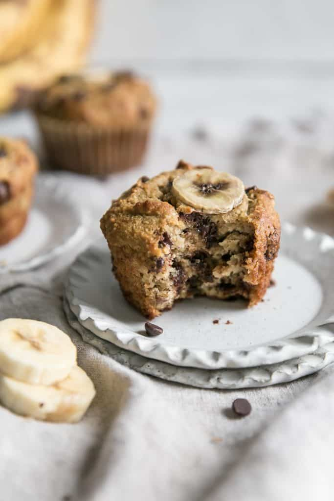 chocolate chip banana muffins with bite on plate
