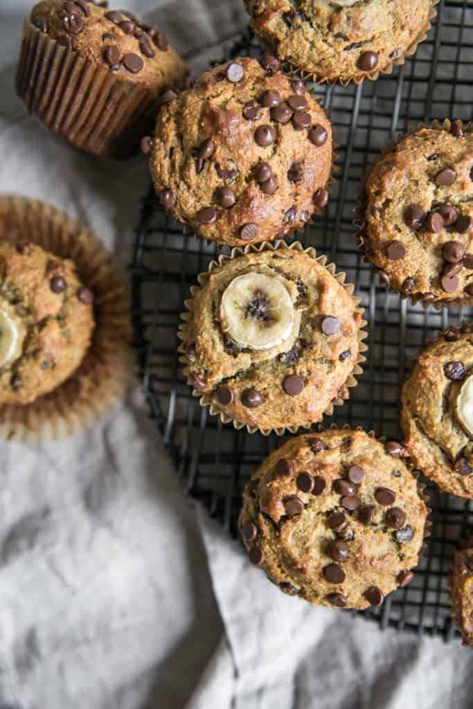 banana chocolate chip muffins cooling on black rack